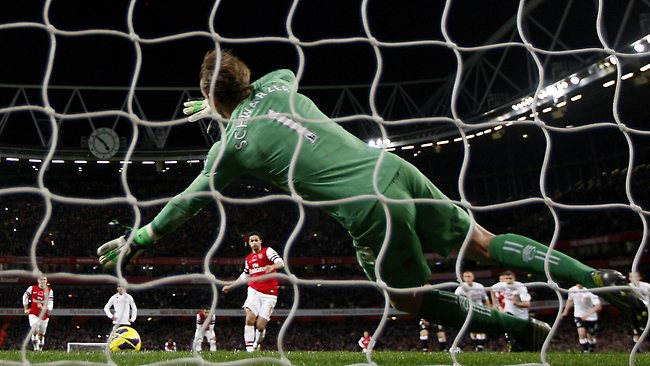 Fulham's Australian goalkeeper Mark Schwarzer saves the penalty taken by Arsenal's Mikel Arteta , during an English Premier League match at the Emirates Stadium. The match ended 3-3. Picture: Ian Kington