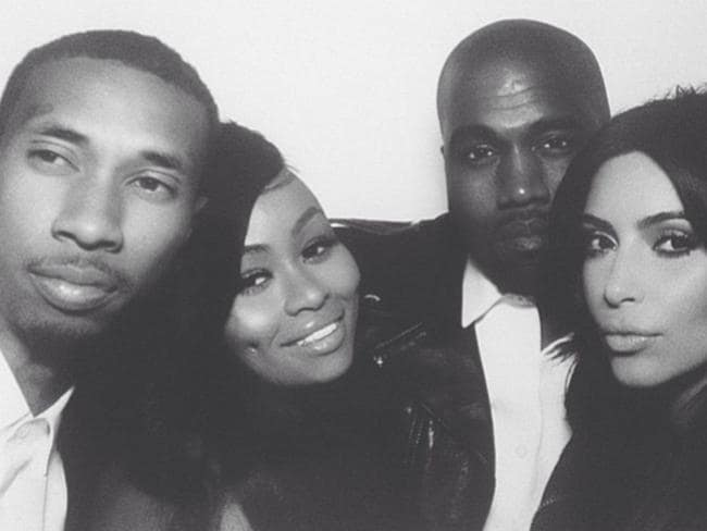 Celebrations ... Kim Kardashian and Kanye West pose with Black Chyna and T-Raww at a photo booth at their wedding reception. Picture: Instagram