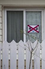""" A sign on a door that shows this house has been seized by the north Korean government."" Picture: Eric Lafforgue/Exclusivepix Media/australscope"