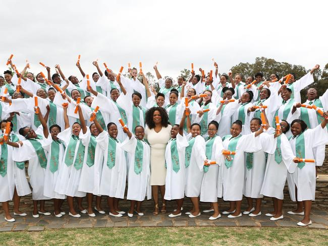Oprah Winfrey with the fifth graduating class from the Oprah Winfrey Leadership Academy for Girls in South Africa.