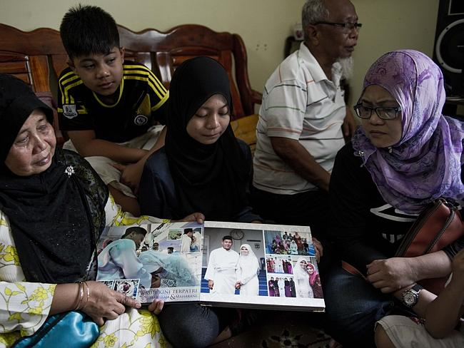 Distressed and waiting ... a relative of Norliakmar Hamid and Razahan Zamani, passengers on a missing Malaysia Airlines Boeing 777-200 plane in Kuala Lumpur Picture: Mohd Rasfan