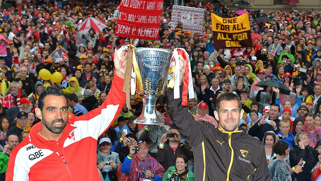 AFL Grand Final Parade, Hawthorn V's Sydney. Adam Goodes with Luke Hodge holding up the Premiership cup Picture: George Salpigtidis