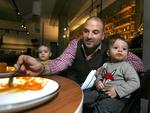 <p>Calombaris with his son James and daughter Juliette at Mama Baba restaurant in South Yarra in June 2012. Picture: Luis Ascui</p>
