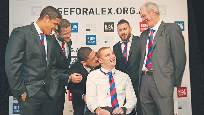 Newcastle Knights forward Alex McKinnon with teammates Dane Gagai, Korbin Sims, Willie Mason, Darius Boyd and coach Wayne Bennett during a press conference at ANZ Stadium for the RiseForAlex round of NRL.
