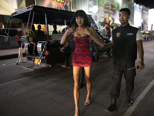 A Thai ladyboy is arrested during police crackdowns in Pattaya. Picture: Paula Bronstein/Getty Images