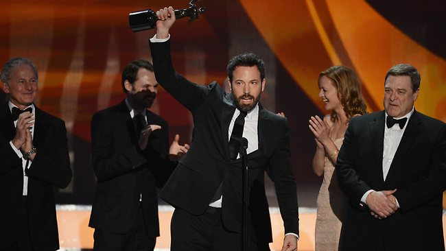 (L-R) Actors Victor Garber; Christopher Denham; Ben Affleck; Kerry Bishe; and John Goodman accept the award for Outstanding Performance by a Cast in a Motion Picture for 'Argo'. Picture: Mark Davis/Getty Images/AFP