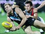 Round 16: Jack Hombsch competes with Essendon's Jackson Merrett. Picture: Sarah Reed