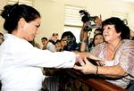 Australian Schapelle Corby (L) holds her mother Rosleigh (R) after her trial in Denpasar.