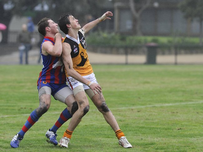 s45wg202 TAC Cup football. Oakleigh Chargers (red Blue) V Dandenong Stingrays (yellow) at Warrawee Park, Oakleigh. Oakleigh's Kieran Nolan and Dandenong's Taylor Garner Picture: Josie Hayden