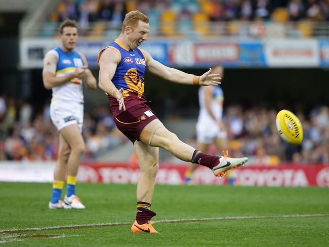Josh Green's Brisbane Lions made the most of the dry conditions, blowing the Suns away in the first term before the rain settled in. Picture: Peter Wallis