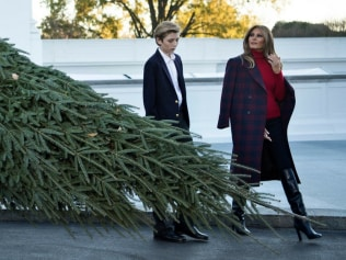 Melania and Baron are have a really jolly Christmas. Photo: AFP