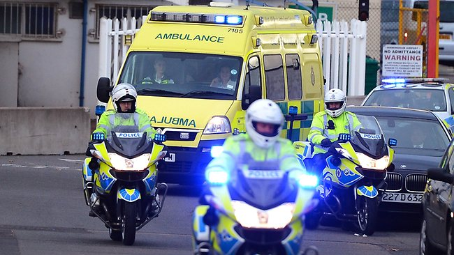 An ambulance transfers 14-year-old Malala Yousafzai, the Pakistani girl shot in the head by Taliban gunmen for campaigning for the right to an education, upon her arrival onboard a plance at Birmingham Airport in Birmingham, central England on October 15, 2012. Yousafzai will be cared for at the Queen Elizabeth Hospital in Birmingham, a highly specialised facility where British soldiers seriously wounded in Afghanistan are treated, a spokeswoman for Prime Minister David Cameron said. AFP PHOTO/ANDREW YATES.