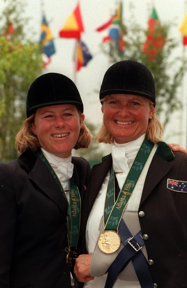 Heavily-injured equestrian champion Gillian Rolton with Wendy Schaeffer wearing gold medals won at the 1996 Atlanta Olympic Games.