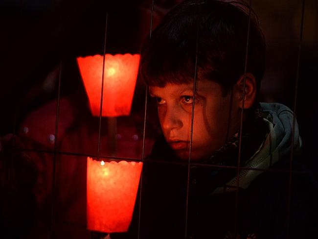 Soul searching ... a boy holds a candle during the Celebration of the Way of the Cross on Good Friday. Picture: Filippo Monteforte