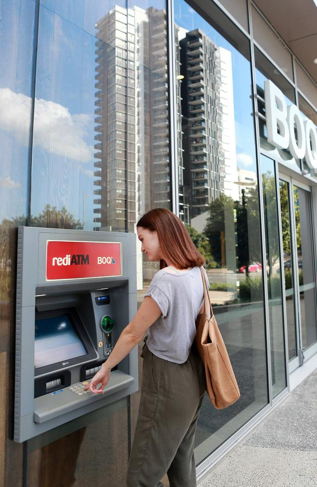 A woman uses an ATM. Picture: AAP/file/Sarah Marshall
