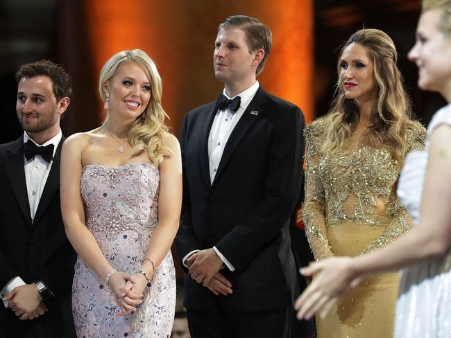 (L-R) Tiffany Trump (2nd L) and her guest Ross Mechanic (L), and Eric Trump and his wife Lara at Donald Trump's inaugural ball. Picture: Getty