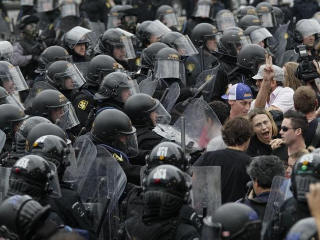 Riot police push against a crowd during a street demonstration on the closing day of the G20 Summit in Toronto, Sunday, June 27, 2010. Picture: AP/Carolyn Kaster