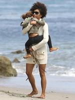 <p>Halle Berry plays with a shy Nahla at the beach in Malibu. Picture: Snappermedia</p>  <br />