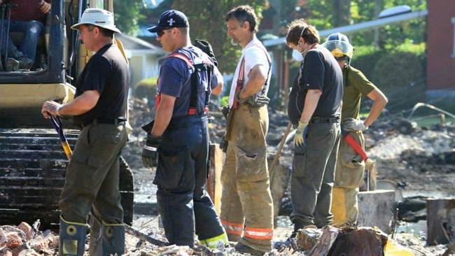 Rescue workers amid destroyed buildings in Lac-Megantic following the derailment and explosion. Picture: AFP