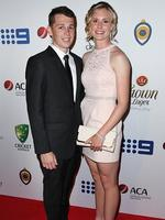 Joshua de Bomfo and Holly Ferling on the red carpet arriving at the 2014 Allan Border Medal held at Doltone House at Hyde Park. Picture: Richard Dobson