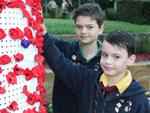 Camira Scouts Jordan and Lachlan Haygarth place poppies into the Springfield Light Tower