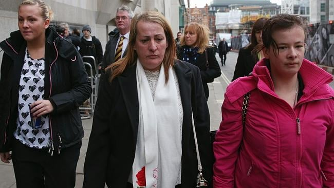 Relatives of murdered fusilier Lee Rigby, his sister Sara McClure, left, and mother Lyn Rigby, centre, arrive at the Old Bailey to attend the first day of the trial of Michael Adebolajo and Michael Adebowale. (Photo by Oli Scarff/Getty Images)