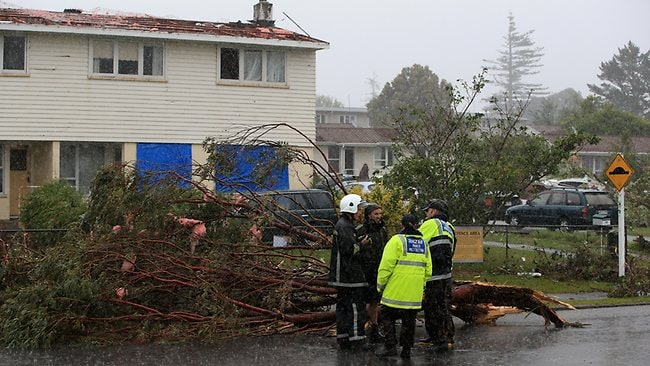 Uprooted trees and storm debris are scattered around the Auckland suburb of Hobsonville in the aftermath of the tornado.Picture: Phil Walter/Getty Images
