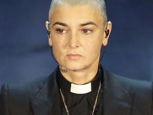"FILE - In this Oct. 5, 2014 file photo, Irish singer Sinead O'Connor performs during the Italian State RAI TV program ""Che Tempo che Fa"", in Milan, Italy. Arsenio Hall sued O'Connor for libel on Thursday, May 5, 2016, in Los Angeles Superior Court over a Facebook post by the singer in which she accused the comedian of furnishing drugs to Prince, who died on April 21, 2016. Investigators are looking into whether he overdosed. (AP Photo/Antonio Calanni, File)"