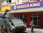 <p>Lebanese army soldiers with their armored personnel carrier, stand guard outside a Burger King as part of stepped up security measures in the southern port city of Sidon, Lebanon. Picture: AP</p>