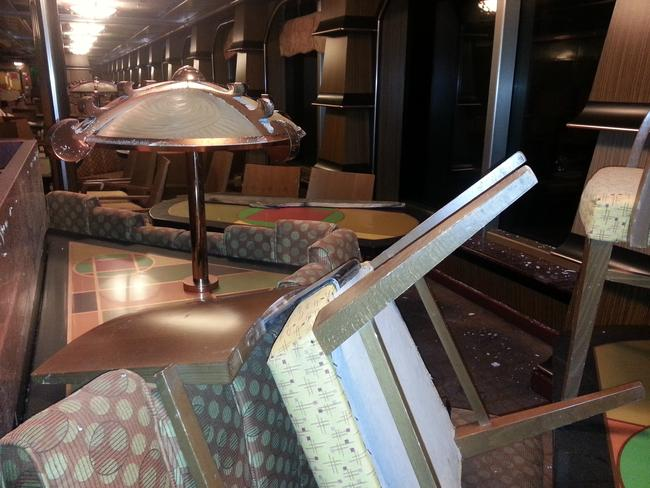 Toppled over ... inside one of the Costa Concordia's lounge areas. Picture: Australpress