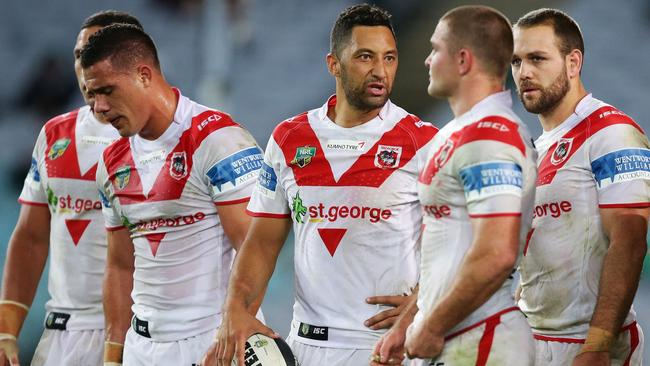 Benji Marshall speaks to dejected team mates after the Rabbitohs score a try.