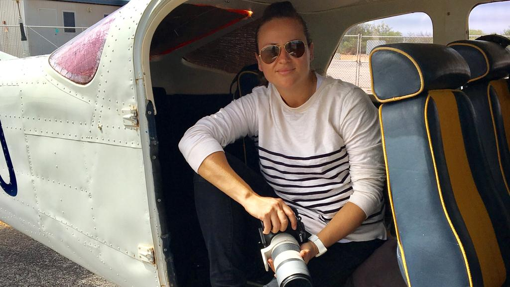 Hulia Boz has gone from photographing the most glamorous celebrities in the world to handing out of a chopper to take amazing landscapes of Australia's coast. Picture: Supplied
