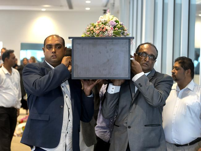 Sameer Sahib (left) carries his daughter's coffin at the little girl's funeral in Melbourne's Dandenong. Picture: Luis Ascui.