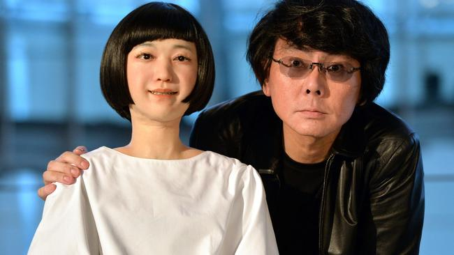 "Osaka University professor Hiroshi Ishiguro with the world's first news reading humanoid robot ""Kodomoroid"" in Tokyo. Source: Yoshikazu TSUNO"