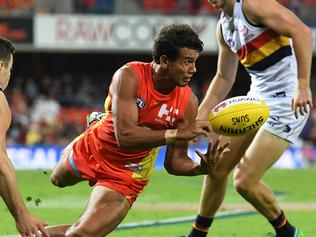 Suns player Callum Ah Chee handballs during the Round 5 AFL match between the Gold Coast Suns and the Adelaide Crows at Metricon Stadium in Carrara on the Gold Coast, Saturday, April 22, 2017. (AAP Image/Dave Hunt) NO ARCHIVING, EDITORIAL USE ONLY