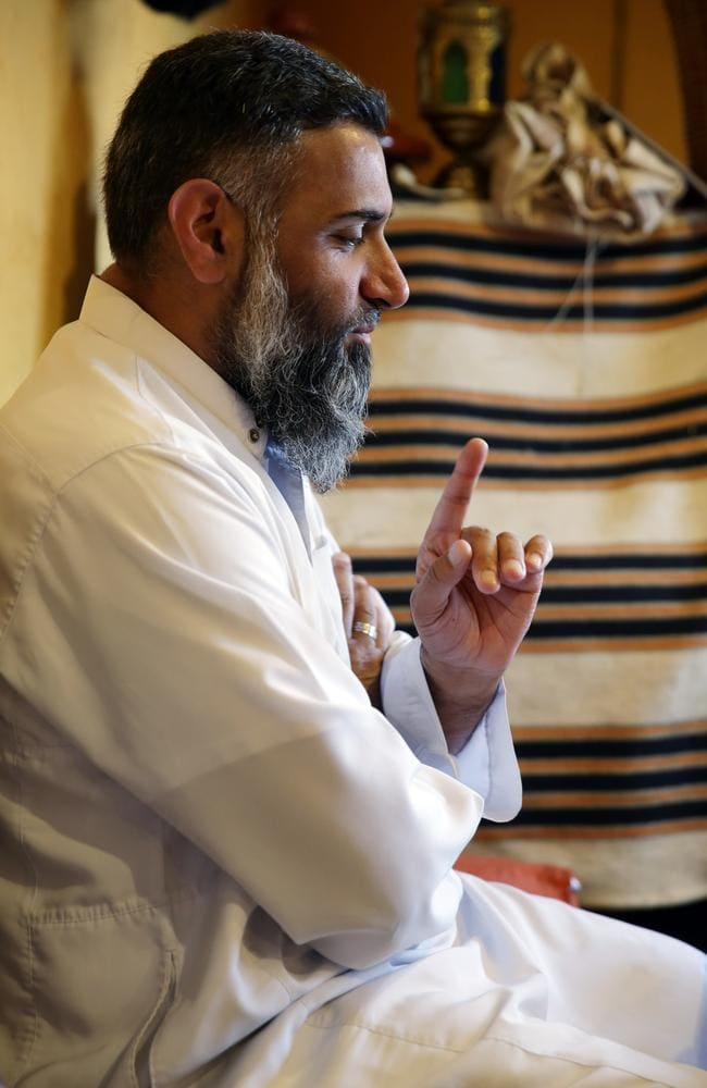 Extreme views ... social and political activist Anjem Choudary in a cafe in East London. He and eight other men were arrested in September 2014 on terrorism-related offences. Picture: Ella Pellegrini
