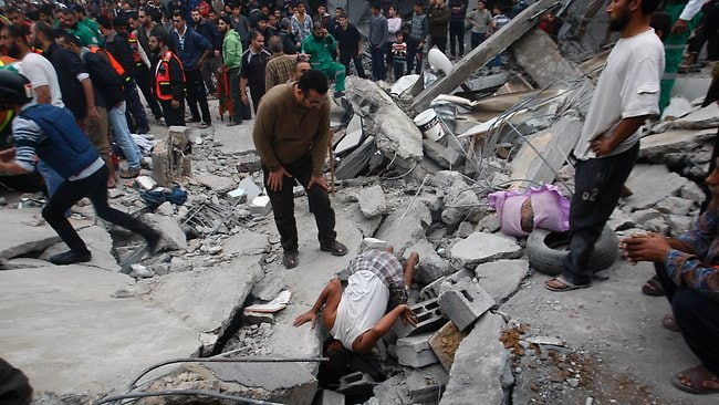 Palestinians inspect the rubble of a destroyed house after an Israeli airstrike in the Jebaliya refugee camp, northern Gaza Strip. Picture: Hatem Moussa