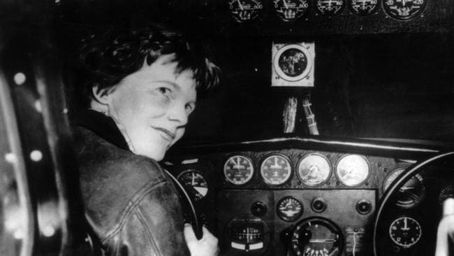 American aviatrix Amelia Earhart at the controls of an aircraft, circa 1930.