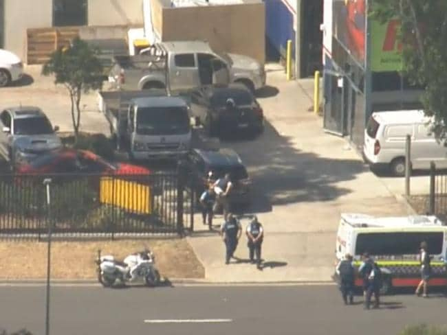 Police at the Ingleburn siege. Picture: Channel 9 News