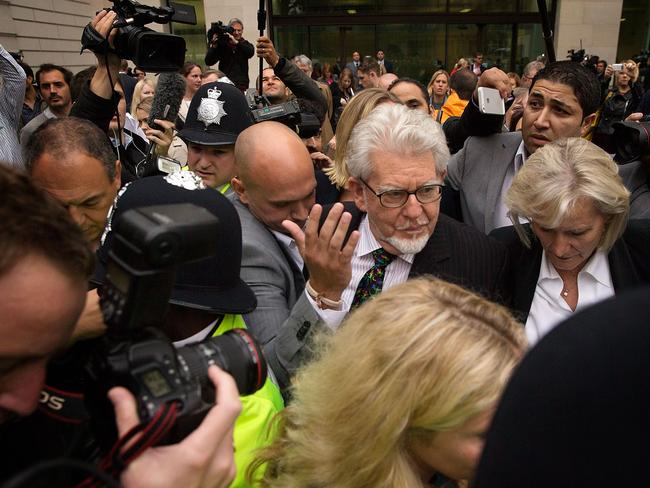 Media circus ... Rolf Harris leaves The City of Westminster Magistrates Court on September 23, 2013.