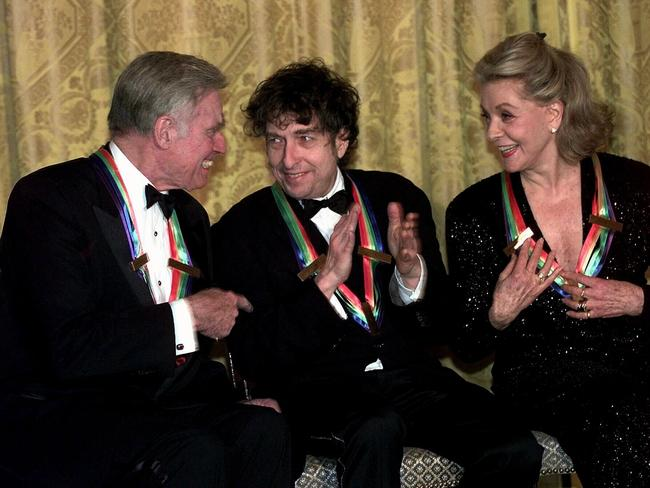 Charlton Heston with singer Bob Dylan and actor Lauren Bacall at Kennedy Centre ceremony honouring them for their impact on the performing arts and American life. Picture: AP