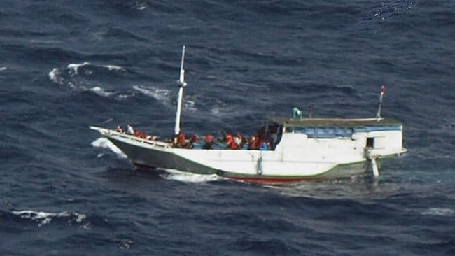 In this handout photo released by the Indonesian National Search and Rescue Agency (Basarnas) taken from an Indonesian Air Force Hercules C-130 aircraft shows a boat believed to be carrying up to 180 asylum-seekers spotted off Indonesia about 50 nautical miles south of Java island and sailing towards Australian waters. Picture: AFP / BASARNAS