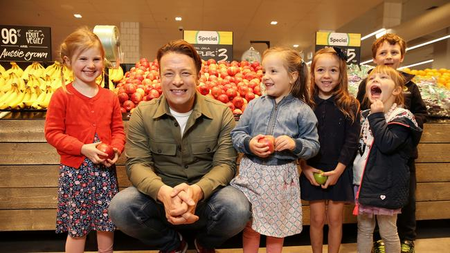 Jamie Oliver within a Woolworths store. He has been a brand ambassador for the supermarket chain since late 2013. Picture: Tim Hunter