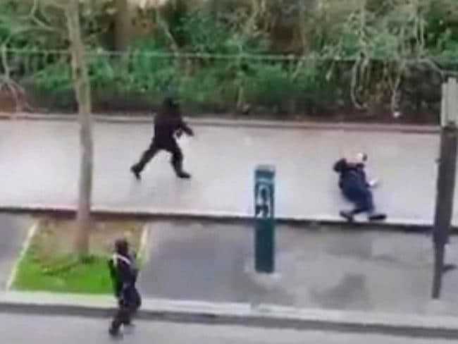 CCTV ... Masked gunman run towards a police officer they execute moments later. Source: AP
