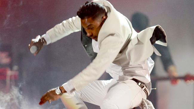 Dangerous jump ... Miguel mid-flight at the Billboard Awards. Picture: Getty