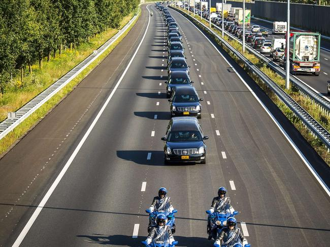 Sombre journey ... A convoy of hearses with the remains of victims of the downed Malaysia Airlines flight MH17, is escorted from the Eindhoven Airbase to Hilversum. Picture: AFP