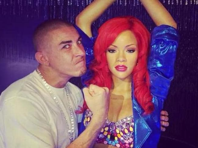 Outrage ... Eso posted this vile image of himself posing with a waxwork figure of Rihanna.