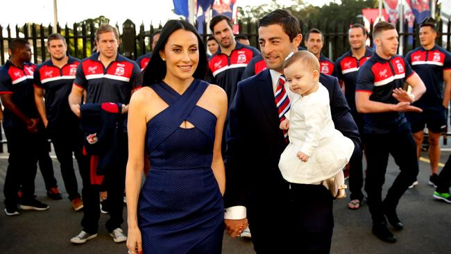 Anthony Minichiello, wife Terry and baby Azura with his Rooster team mates .Picture Gregg Porteous