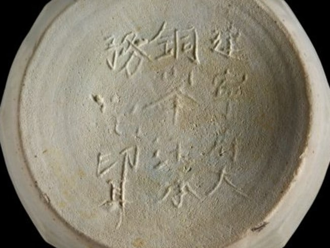 An inscribed piece of pottery recovered from the shipwreck site. Picture: The Field Museum