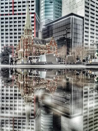 Two sides to King George Square ... shot on the iPhone 6 on July 22 2015. Picture: Rod Chester
